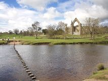 Bolton Priory and stepping stones, Bolton Abbey in North Yorkshire Stock Photos