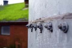 Bolts. On a metal silo in front of a blurred out pig sti Royalty Free Stock Image