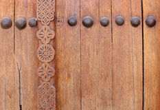 Bolts and beautiful design on ancient door Stock Photo