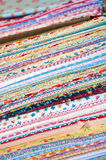 Bolts of colorful fabric in shop Stock Images