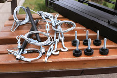 Bolts, fastening, rope lying on a wooden bench Stock Images