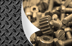 Bolts,gray board,bent corner of the page as background Royalty Free Stock Photo