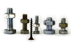 Bolts lined up in front of the screw. Royalty Free Stock Photo
