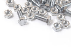 Bolts and nuts. Metal bolts and nuts isolated on a white background royalty free stock photos