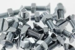 Bolts and nuts closeup Stock Images