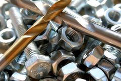 Bolts, nuts and drills Royalty Free Stock Images