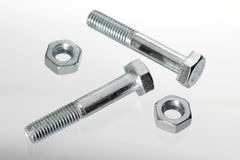 Bolts and nuts on, isolated Stock Image