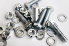 Bolts and nuts. Metal bolts and nuts background Royalty Free Stock Photos