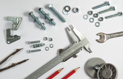 Bolts, Nuts and Screws on White Stock Photos