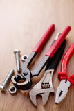 Bolts and nuts with a set of plumbing tools Stock Image