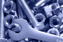 Bolts, nuts and spanner Royalty Free Stock Image
