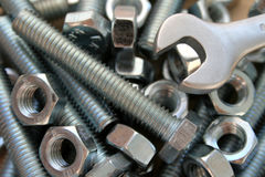 Bolts, nuts and spanner Stock Photos