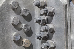 Bolts and nuts in the structure of a steel tower Stock Images