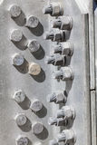 Bolts and nuts in the structure of a steel tower Royalty Free Stock Images