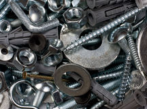 Bolts, nuts, washers, as background Royalty Free Stock Photo