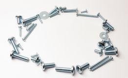 Bolts and nuts on white stock photos