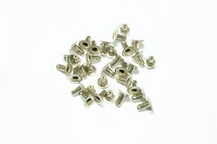 Bolts pile on white background Stock Photos