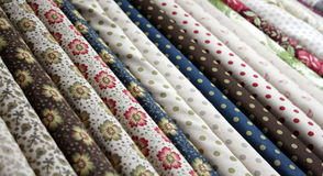Bolts of quilter's cotton material Stock Image