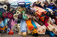 Bolts/rolls of various colored fabric Royalty Free Stock Photo
