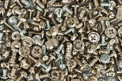 Bolts and screws. Closeup of steel screws and bolts (background Royalty Free Stock Photography