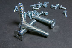 Bolts and Screws on grey. Left upright bolt Stock Images