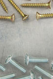 Bolts and screws at metal background Royalty Free Stock Photography