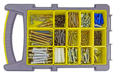 Bolts and screws in the organizer. Container with screws and screws on a white background royalty free stock image