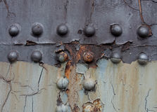 Bolts and Screws on painted surface Stock Photography