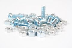 Bolts and screws on white 3. Metal bolts on white background Royalty Free Stock Photo