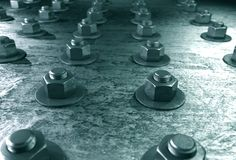 Bolts on steel plating Stock Photography