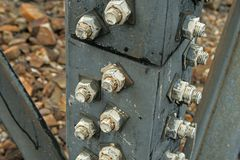 BOLTS IN STRUT OF ELECTRICAL PYLON Stock Photo