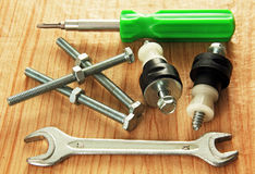 Bolts and tools. Stock Images