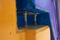 Bolts in between yellow and blue objects royalty free stock images