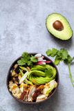Chicken, quinoa and avocado in coconut bowl. Bolw with quinoa, roast chicken and avocado royalty free stock images