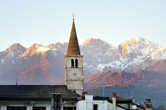 Bolzano, South Tyrol, Italy - view of a bell tower and Dolomites mountains. Bolzano, South Tyrol, Northern Italy - view of a bell tower and Dolomites mountains royalty free stock images