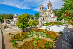 Bom Jesus do Monte. Aerial view of neoclassical Bom Jesus do Monte Sanctuary and magnificent flowered gardens in a sunny day. Tenoes near Braga. The Basilica is Royalty Free Stock Photo