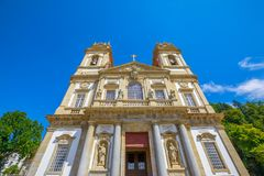 Bom Jesus do Monte. Facade of the Bom Jesus do Monte Sanctuary in neoclassical style in a sunny day. Tenoes near Braga, north of Portugal, Europe. Perspective Stock Photo