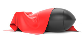 Bomb covered from above a red silk cloth Royalty Free Stock Photo