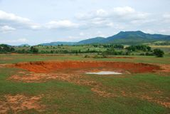 Bomb craters in the world`s most heavily bombed place. Near the Plain of Jars archaeological site in Phonsavan, Laos Stock Photography