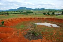 Bomb craters in the world`s most heavily bombed place. Near the Plain of Jars archaeological site in Phonsavan, Laos Stock Image