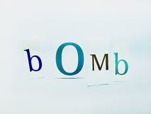 Bomb - Cutout Words Collage Of Mixed Magazine Letters with White Background. Caption composed with letters torn from magazines with White Background Royalty Free Stock Photography