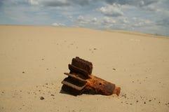 Bomb in desert. Old bomb on the desert stock image