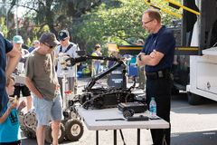Bomb diffusion robot used by police. Portland, OR / USA - August 18 2018: Bomb diffusion robot used by police and SWAT special unit at the outdoor fair stock photo