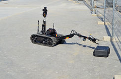 Bomb Disposal Robot. A remote controlled bomb disposal robot being put through its paces Stock Photo