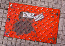 Bomb eros. A joke with the firemen`s plaque in Argentina. Firefighters, in Spanish. The idea is of bomb plus Eros, the Greek God Royalty Free Stock Photos