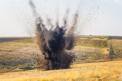 Bomb explosion. Big explosion on the field Royalty Free Stock Photos