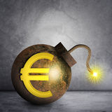 Bomb with ignited fuse. Bomb with euro sign and ignited fuse on grey wall background Royalty Free Stock Image