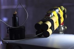A bomb with a mobile phone. Blow up terrorists with the help of a detonator. Shallow depth of cut. Stock Photo