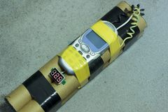 A bomb with a mobile phone. Blow up terrorists with the help of a detonator. Shallow depth of cut. Stock Photos