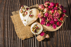 Bomb salt bath decorated with dried roses on a wooden background. Bomb bath decorated with dried roses on a wooden background Royalty Free Stock Photos